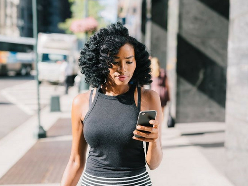 black woman checking phone