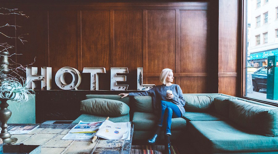 young woman sitting in hotel